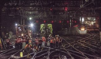 In this Wednesday, April 5, 2017 photo provided by Amtrak, workers repair rails inside New York's Penn Station. Amtrak says it hopes to restore full service to New York's Penn Station by Friday, four days after a second derailment in less than two weeks. Monday's derailment of a New Jersey Transit commuter train damaged switches, signals and rails at a spot where two tracks emerge from a tunnel and diverge to 21 tracks. (Chuck Gomez/Amtrak via AP)