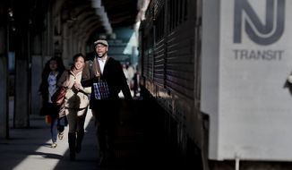 New Jersey Transit commuters rush to catch a train heading for Gladstone, N.J., Wednesday, April 5, 2017, in Hoboken, N.J. The heads of the two major commuter rail lines that use New York's Penn Station took turns criticizing Amtrak on Wednesday for two recent derailments that continued to cause headaches for commuters in the nation's busiest rail hub. (AP Photo/Julie Jacobson)