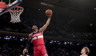 Washington Wizards guard John Wall (2) goes up to dunk the ball against the New York Knicks during the first quarter of an NBA basketball game, Thursday, April 6, 2017, in New York. (AP Photo/Julie Jacobson)