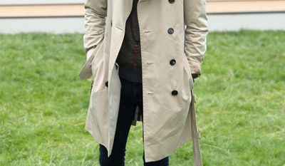 FILE - In this June 18, 2013 file photo, garbed in a classically styled trench coat, actor Jamie Campbell Bower arrives at a Burberry fashion show in London. Burberry supplied British officers serving in the trenches of World War I with khaki-colored, waterproof trench coats. Now, as Thursday, April 6, 2017, marks the 100th anniversary of the U.S. entry into World War I, many of the technology innovations developed during the conflict, including the trench coat, are still with us. (Photo by Jonathan Short/Invision/AP, File)