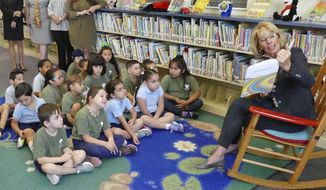 Secretary of Education Betsy DeVos reads Dr. Seuss to Kindergarten students at Royal Palm Elementary School in Miami on Friday, April 7, 2017.   (C.M. Guerrero/El Nuevo Herald via AP)