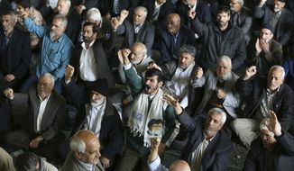 "Iranian worshippers chant slogan ""death to America"" during their Friday prayer ceremony at the Tehran University campus in Tehran, Friday, April 7, 2017. A senior cleric called missile attacks by the U.S on a Syrian air base ""crimes"" and accused America of providing chemical weapons to rebels. (AP Photo/Vahid Salemi)"