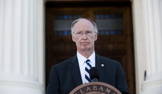 Alabama Gov. Robert Bentley speaks during a news conference on Friday, April 7, 2017, outside the Alabama Capitol building in Montgomery, Ala. Bentley vowed again  he won't resign even as his political troubles mounted and lawmakers said they would move forward with impeachment hearings because of a sex scandal.  (Albert Cesare /The Montgomery Advertiser via AP)