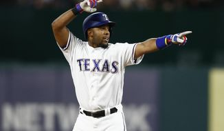 Texas Rangers' Elvis Andrus celebrates his double against the Oakland Athletics during the sixth inning of a baseball game, Friday, April 7, 2017, in Arlington, Texas. (AP Photo/Jim Cowsert)
