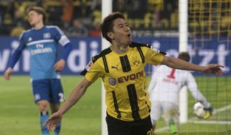Dortmund's Shinji Kagawa celebrates his goal during the German Bundesliga soccer match between Borussia Dortmund and Hamburg SV in the Signal Iduna Park in Dortmund, Germany, Tuesday, April 4, 2017. (Bernd Thissen/dpa via AP)