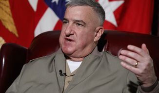 Assistant Commandant of the Marine Corps Gen. Glenn Walters speaks during an interview, Friday, April 7, 2017, at the Pentagon. Two male Marines have been demoted and about two dozen other military members are being investigated in connection with the investigation into nude photographs that were shared online, the Marine Corps said Friday. (AP Photo/Evan Vucci)