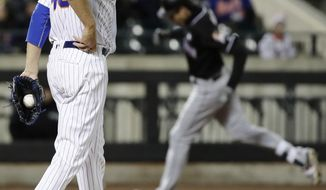 New York Mets starting pitcher Zack Wheeler walks on the mound as Miami Marlins' Christian Yelich runs the bases after hitting a two-run home run during the third inning of a baseball game Friday, April 7, 2017, in New York. (AP Photo/Frank Franklin II)