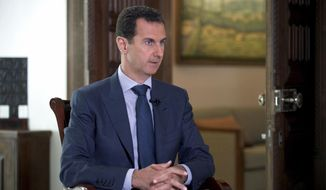 "In this Wednesday, Sept. 21, 2016, file photo released by the Syrian Presidency, Syrian President Bashar Assad speaks to The Associated Press at the presidential palace in Damascus, Syria. Syria decried a U.S. missile strike early Friday, April 7, 2017, on a government-controlled air base where U.S. officials say the Syrian military launched a deadly chemical attack earlier this week. Syria called the operation ""an aggression"" that killed at least six people. (Syrian Presidency via AP, File)"