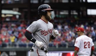 Washington Nationals' Bryce Harper runs to home after hitting a two run homer off of Philadelphia Phillies starting pitcher Vince Velasquez (28)  in the first inning of a baseball game in Philadelphia, Friday, April 7, 2017. (AP Photo/Matt Rourke)