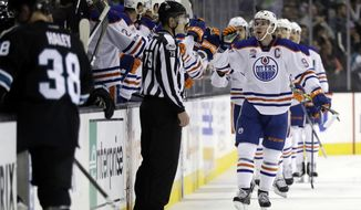 Edmonton Oilers' Connor McDavid, center, celebrates his goal against the San Jose Sharks during the second period of an NHL hockey game Thursday, April 6, 2017, in San Jose, Calif. (AP Photo/Marcio Jose Sanchez)
