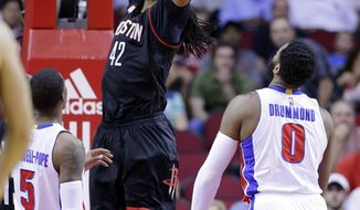 Houston Rockets' Nene (42) dunks between Detroit Pistons' Kentavious Caldwell (5) and Andre Drummond (0) during the first half of an NBA basketball game Friday, April 7, 2017, in Houston. (AP Photo/Michael Wyke)