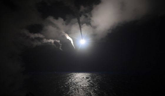 In this file image provided on Friday, April 7, 2017, by the U.S. Navy, the guided-missile destroyer USS Porter (DDG 78) launches a Tomahawk land attack missile in the Mediterranean Sea. The U.S. missile attack has caused heavy damage to one of Syria's biggest and most strategic air bases, used to launch warplanes to strike opposition-held areas in central, northern and southern Syria. (Mass Communication Specialist 3rd Class Ford Williams/U.S. Navy via AP, File)