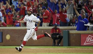 Texas Rangers' Mike Napoli rounds first after hitting a solo home run off Oakland Athletics starting pitcher Kendall Graveman during the seventh inning of a baseball game, Saturday, April 8, 2017, in Arlington, Texas. Napoli's home run spoiled Graveman's no-hit bid. (AP Photo/Jeffrey McWhorter)