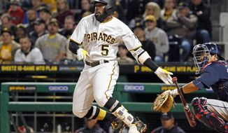 Pittsburgh Pirates' Josh Harrison (5) drives in a run with a double off Atlanta Braves starting pitcher R.A. Dickey in the third inning of a baseball game in Pittsburgh, Saturday, April 8, 2017. (AP Photo/Gene J. Puskar)