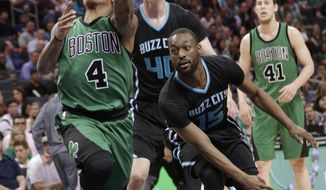Boston Celtics' Isaiah Thomas (4) drives past Charlotte Hornets' Kemba Walker (15) during the first half of an NBA basketball game in Charlotte, N.C., Saturday, April 8, 2017. (AP Photo/Chuck Burton)
