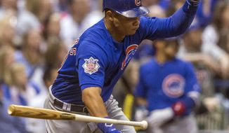 Chicago Cubs' Wilson Contreras hits a bases loaded two RBI-double off of Milwaukee Brewers' Brent Suter during the eighth inning of a baseball game Saturday, April 8, 2017, in Milwaukee. (AP Photo/Tom Lynn)