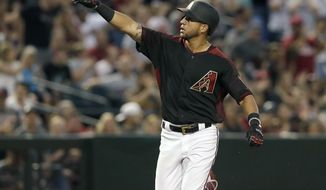 Arizona Diamondbacks David Peralta reacts after hitting a solo home run in the sixth inning during a baseball game against the Cleveland Indians, Saturday, April 8, 2017, in Phoenix. (AP Photo/Rick Scuteri)