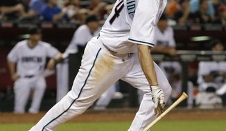 Arizona Diamondbacks first baseman Paul Goldschmidt watches his two-run double in the fifth inning of a baseball game against the Cleveland Indians, Friday, April 7, 2017, in Phoenix. (AP Photo/Rick Scuteri)