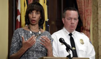 FILE - In this Tuesday, April 4, 2017 file photo, Baltimore Mayor Catherine Pugh, left, speaks alongside Baltimore Police Department Commissioner Kevin Davis at a news conference at City Hall in Baltimore, in response to the Department of Justice's request for a 90-day delay of a hearing on its proposed overhaul of the Baltimore Police Department. An agreement negotiated under the Obama administration to overhaul the troubled Baltimore Police Department will go ahead despite objections from the Trump administration. Pugh disputed the notion the decree will hurt the fight against crime. (AP Photo/Patrick Semansky, File)