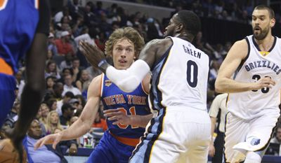 New York Knicks' Ron Baker drives on Memphis Grizzlies' JaMychal Green during the first half of an NBA basketball game Friday, April 7, 2017, in Memphis, Tenn. (AP Photo/Karen Pulfer Focht)