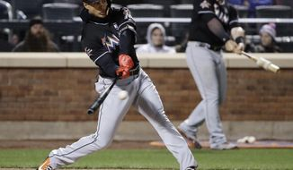 Miami Marlins' Giancarlo Stanton hits a single during the fifth inning of a baseball game against the New York Mets, Saturday, April 8, 2017, in New York. (AP Photo/Frank Franklin II)