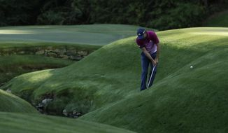 Sergio Garcia, of Spain, hits from a hill on the 13th hole during the third round of the Masters golf tournament Saturday, April 8, 2017, in Augusta, Ga. (AP Photo/Matt Slocum)