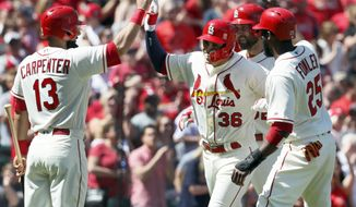 St. Louis Cardinals' Aledmys Diaz (36) is congratulated by teammates Matt Carpenter (13), Dexter Fowler (25) and Michael Wacha after hitting a three-run home run during the fourth inning of a baseball game against the Cincinnati Reds Saturday, April 8, 2017, in St. Louis. (AP Photo/Jeff Roberson)
