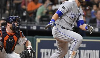 Kansas City Royals' Alex Gordon watches hits his two-run double in the eighth inning of a baseball game against the Houston Astros, Saturday, April 8, 2017, in Houston. (AP Photo/Eric Christian Smith)