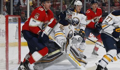 Florida Panthers right wing Reilly Smith (18) gets into position next to Buffalo Sabres goaltender Robin Lehner (40) for a tip in-attempt during the first period of an NHL hockey game, Saturday, April 8, 2017, in Sunrise, Fla. (AP Photo/Joel Auerbach)