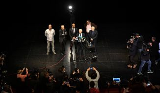 French Mayor of Bayonne Jean-Rene Etchegaray, fourth left, delivers his speech ahead of the announcement by Ram Manikkalingam, third left, president of the Verification Commission for disarmament of ETA, the Basque separatist group, that ETA handed over its arms in Bayonne, southwestern France, Saturday, April 8, 2017. The Basque separatist group ETA, inactive for more than five years, handed over its arms Saturday, putting a finishing touch to a 43-year violent campaign that claimed the lives of over 800 people mostly in Spain. (AP Photo/Alvaro Barrientos)