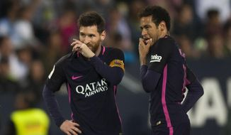 FC Barcelona's Lionel Messi, left, and Neymar da Silva from Brazil, right, gesture during their match against CF Malaga in a Spanish La Liga soccer match between Malaga and Barcelona in Malaga, Spain, Saturday April 8, 2017. (AP Photo/Daniel Tejedor)