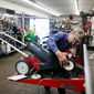 Gary Taylor, an employee of Brodd's Small Engine Repair in Lincoln, Nebraska, works on a lawn mower. Tim Brodd, the shop's owner, prefers fuel without ethanol if it's available. (Associated Press)