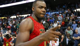 Atlanta Hawks forward Paul Millsap (4) celebrates the overtime victory as he leaves the court after an NBA basketball game against the Cleveland Cavaliers, Sunday, April 9, 2017, in Atlanta. The Hawks won in overtime 126-125. (AP Photo/Todd Kirkland)