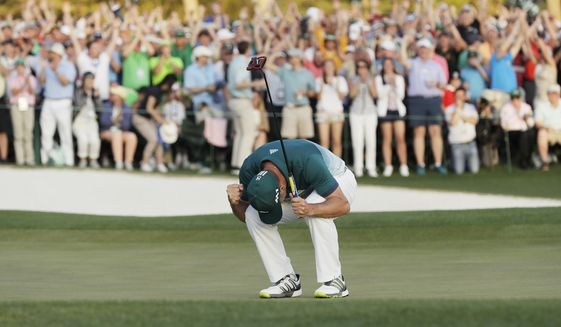 Sergio Garcia, of Spain, reacts after making his birdie putt on the 18th green to win the Masters golf tournament after a playoff Sunday, April 9, 2017, in Augusta, Ga. (AP Photo/David J. Phillip)