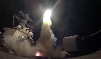 In this Friday, April 7, 2017, file image provided by the U.S. Navy, the guided-missile destroyer USS Porter (DDG 78) launches a Tomahawk land attack missile in the Mediterranean Sea as the United States blasted a Syrian air base with a barrage of cruise missiles in fiery retaliation for a gruesome chemical weapons attack against civilians earlier in the week. (Mass Communication Specialist 3rd Class Ford Williams/U.S. Navy via AP, File)