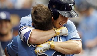 Tampa Bay Rays' Corey Dickerson, right, hugs Steven Souza Jr. after his home run during the third inning of a baseball game against the Toronto Blue Jays, Sunday, April 9, 2017, in St. Petersburg, Fla. (AP Photo/Mike Carlson)