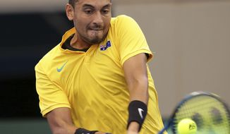 Nick Kyrgios of Australia plays a shot in his match against Sam Querrey of the U.S. at the Davis Cup World Group Quarterfinal in Brisbane, Australia, Sunday, April 9, 2017. (AP Photo/Tertius Pickard)