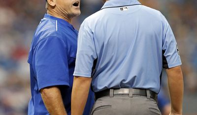 Toronto Blue Jays manager John Gibbons, left, argues with first base umpire Mike Winters during the third inning of a baseball game against the Tampa Bay Rays, Sunday, April 9, 2017, in St. Petersburg, Fla. (AP Photo/Mike Carlson)