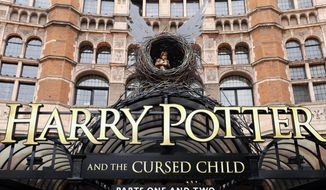"FILE - In this Thursday, July 28, 2016 file photo, the Palace Theatre in London shows advertising for Harry Potter play ""Harry Potter and the Cursed Child"".  The staged sequel to J.K. Rowling's wizarding saga is nominated in 11 categories of the Olivier Stage Awards, which will be announced in London Sunday April 9, 2017. (AP Photo/Kirsty Wigglesworth, file)"