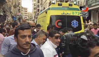 This frame grab from video shows an ambulance outside Saint Mark's Cathedral following a suicide bombing that killed several people, just after Coptic Pope Tawadros II finished services, in the coastal city of Alexandria, Egypt, Sunday, April 9, 2017. Bombs tore through two Egyptian churches in different cities as worshippers were marking Palm Sunday, both claimed by the Islamic State group. (Al-Masry Al-Youm, via AP) ** FILE **