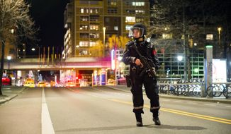 "An officer stands guard as police cordon off a large area around a subway station on a busy commercial street Saturday night, April 8, 2017, after finding what they described as a ""bomb-like"" device, in Oslo, Norway. The official police Twitter account said one man has been arrested and Police Chief Vidar Pedersen said police were working to disarm it. (Fredrik Varfjell /NTB scanpix via AP)"