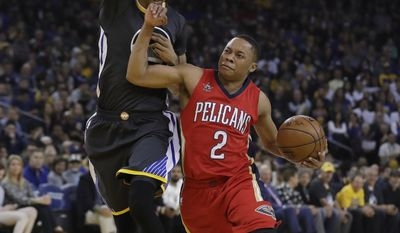 New Orleans Pelicans' Tim Frazier (2) is defended by Golden State Warriors' Shaun Livingston during the first half of an NBA basketball game Saturday, April 8, 2017, in Oakland, Calif. (AP Photo/Marcio Jose Sanchez)
