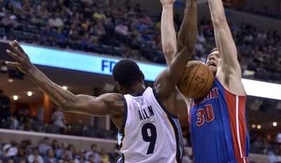 Memphis Grizzlies guard Tony Allen (9) and Detroit Pistons forward Jon Leuer (30) collide in the first half of an NBA basketball game Sunday, April 9, 2017, in Memphis, Tenn. (AP Photo/Brandon Dill)