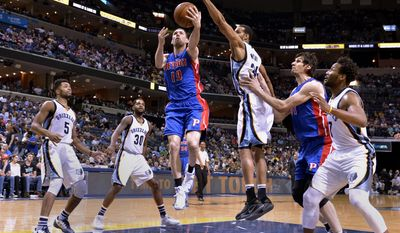 Detroit Pistons guard Beno Udrih (19) shoots between Memphis Grizzlies guard Andrew Harrison, from left, guard Troy Daniels, forward Brandan Wright, Pistons center Boban Marjanovic, and guard Wayne Selden in the first half of an NBA basketball game Sunday, April 9, 2017, in Memphis, Tenn. (AP Photo/Brandon Dill)