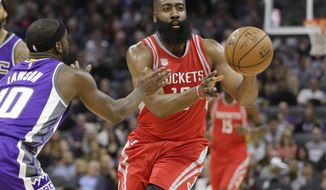Houston Rockets guard James Harden, right, passes against Sacramento Kings guard Ty Lawson during the first half of an NBA basketball game, Sunday, April 9, 2017, in Sacramento, Calif. (AP Photo/Rich Pedroncelli)