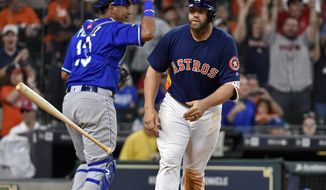 Houston Astros designated hitter Evan Gattis tosses his bat after drawing a bases-loaded walk to score George Springer and win the baseball game against the Kansas City Royals in twelve innings, Sunday, April 9, 2017, in Houston. (AP Photo/Eric Christian Smith)