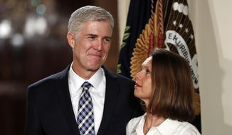 In this Tuesday, Jan. 31, 2017, file photo, Judge Neil Gorsuch stands with his wife Marie Louise Gorsuch as President Donald Trump announces him as his choice for the Supreme Court in the East Room of the White House in Washington. (AP Photo/Carolyn Kaster, File)