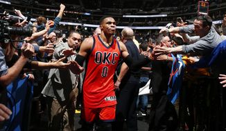 Oklahoma City Thunder guard Russell Westbrook celebrates after hitting a buzzer beating three point shot to win the game against the Denver Nuggets Sunday, April 9, 2017, in Denver. Oklahoma City defeated Denver 106-105. Westbrook also broke the NBA record for triple doubles with 42 for the season. (AP Photo/Jack Dempsey)