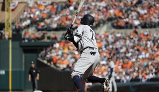 New York Yankees' Ronald Torreyes triples in the sixth inning of a baseball game against the Baltimore Orioles in Baltimore, Sunday, April 9, 2017. Aaron Judge and Austin Romine scored on the play. (AP Photo/Patrick Semansky)