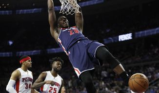Washington Wizards center Ian Mahinmi dunks during second half of an NBA basketball game against the Detroit Pistons, Monday, April 10, 2017, in Auburn Hills, Mich. (AP Photo/Carlos Osorio)